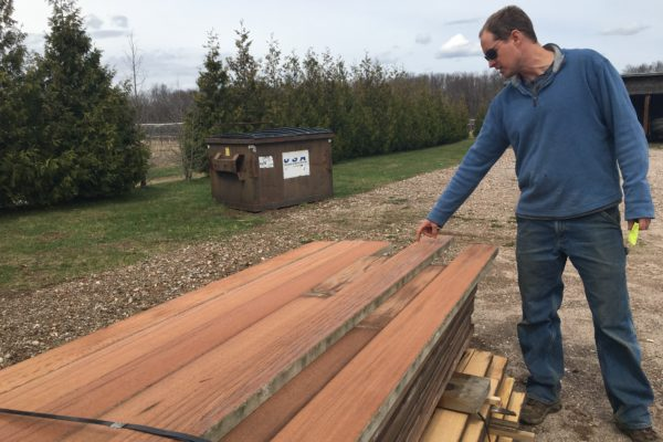 Klaas Armster reviewing reclaimed wood tank staves